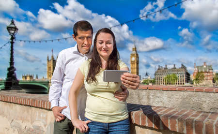 bigben: happy couple taking selfie picture in the travel in London Stock Photo