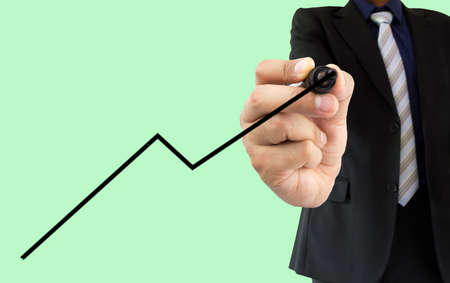 felt tip pen: businessman drawing a line graph with felt tip pen on a transparent wipeboard isolated on a green background