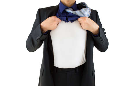 ripping shirt: shot of a confident businessman ripping open his shirt and exposing a costume underneath