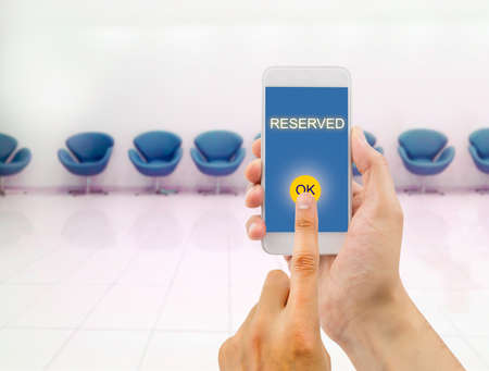 ecomerce: man vip seat reserved for an event with the smartphone Stock Photo