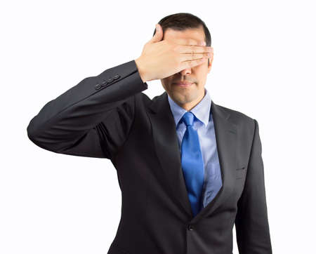 unsighted: Portrait of an businessman covering his eyes isolated on white background