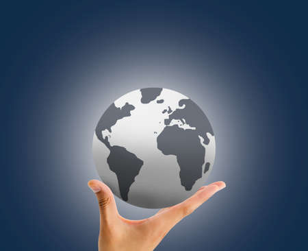 businessman carrying a globe: hand holding the globe with the palm over blue background