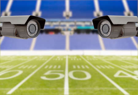 CCTV security camera on the roof of american football on the stadium