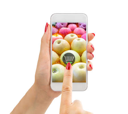 Closeup of hands using smartphone in supermarket and buying apples .The screen content is designed by me and not is copyrighted by others and created with wacom tablet and PS Stock Photo