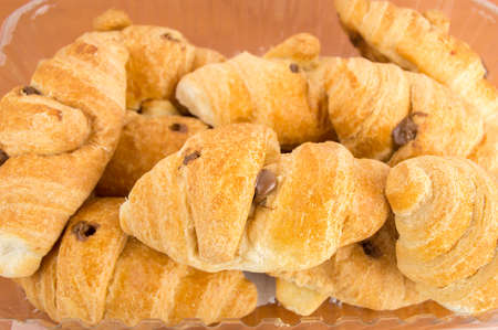 cropped shot: A cropped shot of freshly-baked croissants Stock Photo