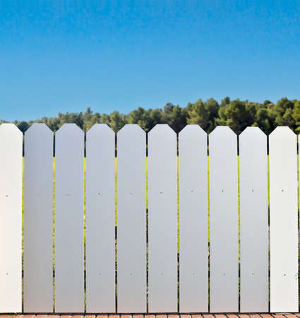 aluminum fence at the countryside with the blue sky in background Stock Photo