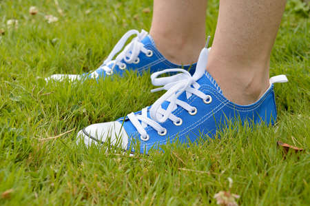 profile view of blue sneaker isolated on a grass Stock Photo