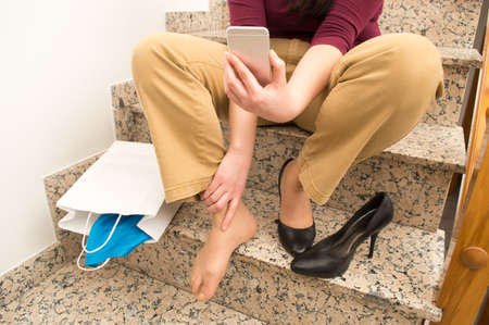 tripped: woman falling on the stairs and calling by phone to emergency