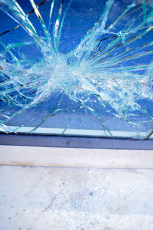 close up of broken office window glass