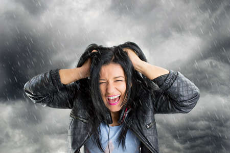 rain wet: Surprised and excited screaming woman isolated with storm and rain in background Stock Photo