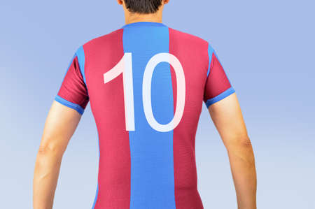 cropped rear view image of a football player wearing a blue and garnet t shirt Stock Photo