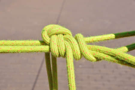 belaying: closeup of a great knot on a climbing rope