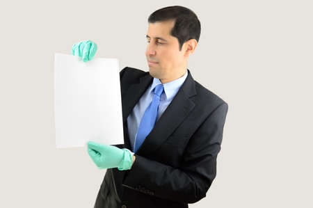 revulsion: businessman holding a document with gloves over a white background