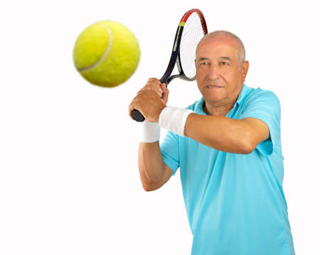 70s tennis: portrait of a senior man tennis player standing and swatting the ball Stock Photo