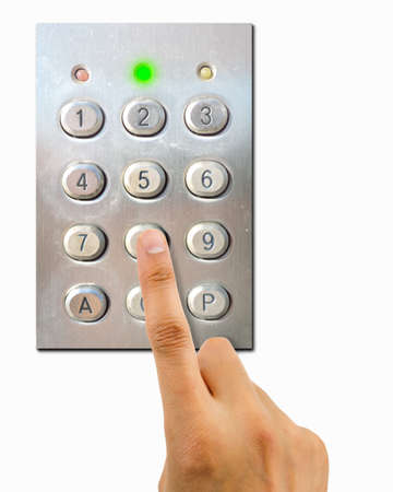 pin code: hand pressing the combination of a keypad with green light as concept of correct password Stock Photo
