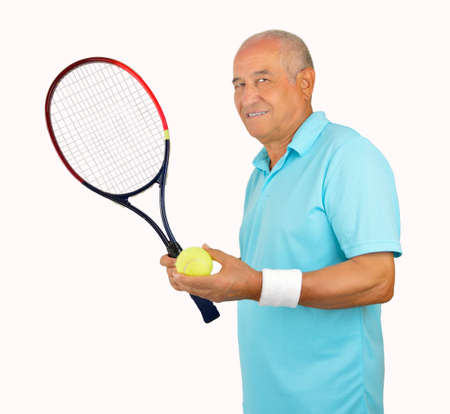 70s tennis: Smiling senior man standing and holding his racquet tennis over white background
