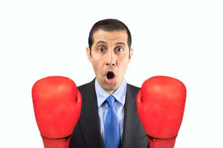 adult oops: Portrait of a shocked businessman with boxing gloves isolated on white background