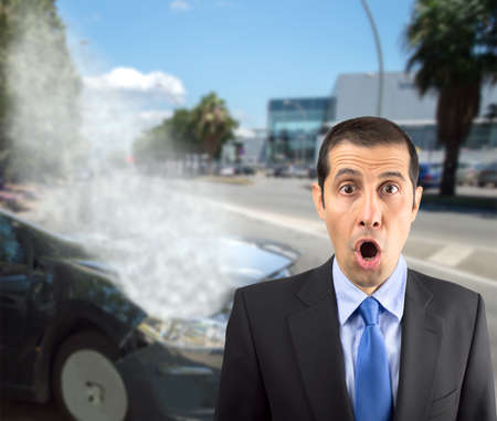 adult oops: Portrait of a shocked businessman at the road with my accident car Stock Photo