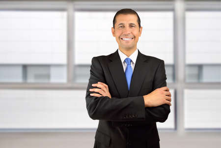 one man only: Cropped portrait of a businessman standing with his arms folded in his office Stock Photo