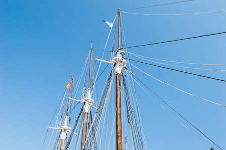 detail of old sailing ship masts with the blue sky on the background