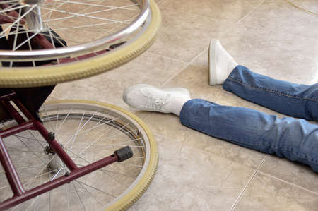 powerless: Disabled man with handicap having an accident crash with wheelchair a at home. Disability concept with powerless unhelped person lying on the floor