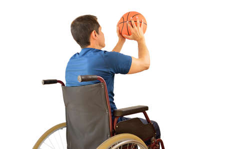 rear view of a basketball player in free throw pose in wheelchair isolated in white background
