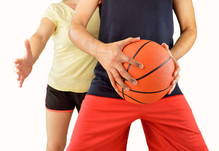 couple of friends playing basketball with white background