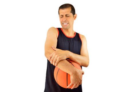 luxacion: Disparo de un jugador de baloncesto con una lesión en el codo sobre el fondo blanco Foto de archivo