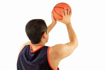 rearview: Cropped rearview of a basketball player taking free throw against white background  Stock Photo