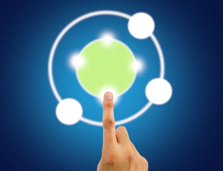 close up of man pushing virtual circle and copy space with blue background. Stock Photo