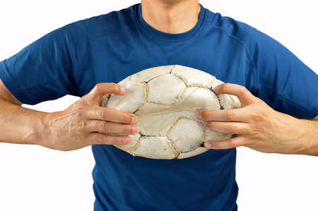 agressive: loser angry and aggressive player football holding the damaged soccer football isolated on white background Stock Photo
