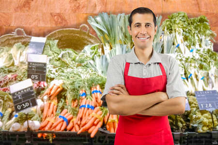 crossing arms: portrait of shopman at the vegetables store with crossing arms