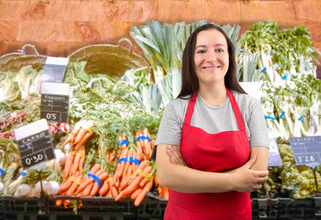 saleslady: portrait of saleswoman at the vegetables store with crossing arms Stock Photo