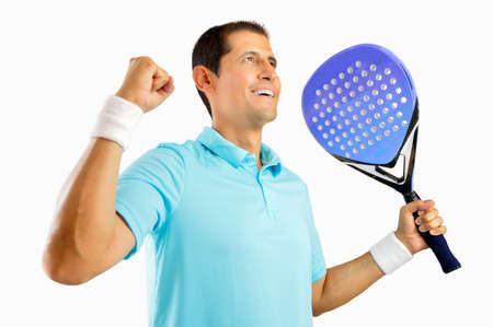 Portrait of a young male paddle tennis player celebrating a victory isolated on white background