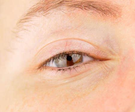 closeup of a brown eye woman looking Stock Photo