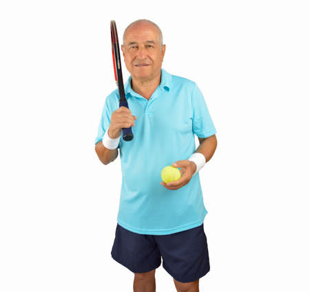 70s tennis: Smiling senior man standing and holding his racquet tennis isolated over white background Stock Photo