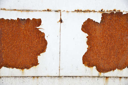 shot of a white metal door with rust Stock Photo