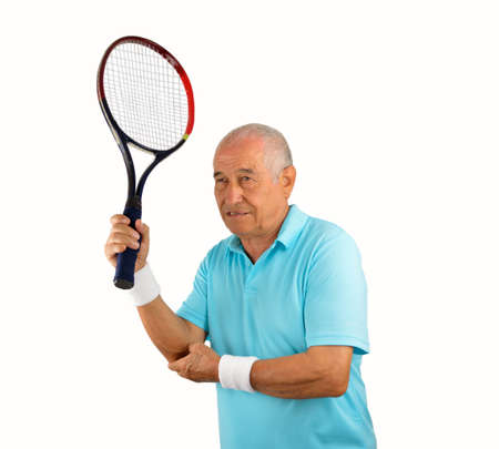 Shot of a tennis player with a elbow injury over white background Stock Photo