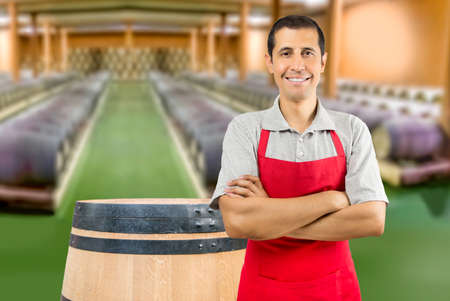 portrait of man with crossed arms at wine cellar Stock Photo