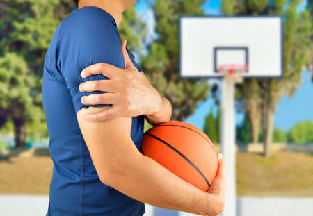oudoors: Shot of a basketball player with a shoulder injury at oudoors