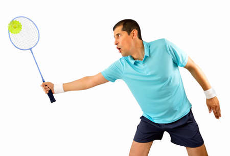 shuttlecock: portrait of a young male badminton player standing and swatting the ball isolated on white background