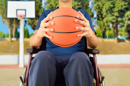 cropped basketball player in wheelchair at outdoors