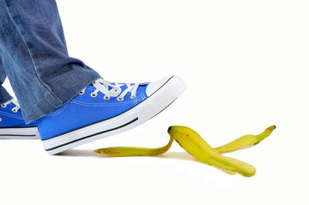 young man stepping on banana skin peel work accident concept