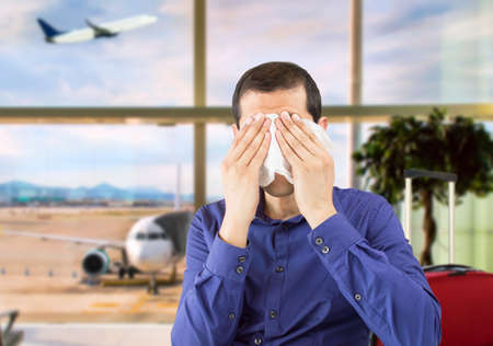 Portrait of divorced man crying like child at airport departure lounge Stock Photo
