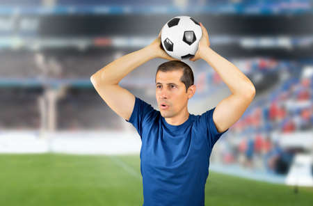 Cropped shot of a young soccer player taking off at stadium Stock Photo