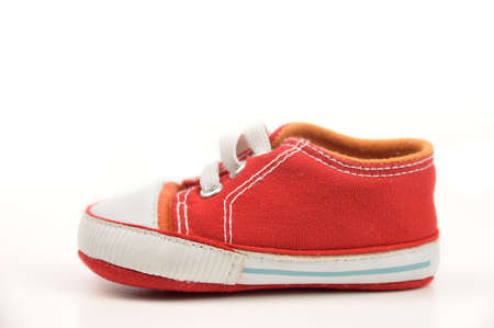 One baby sneaker on white background