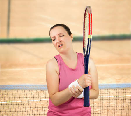 shot of a tennis player with a wrist injury on a clay court Stock Photo