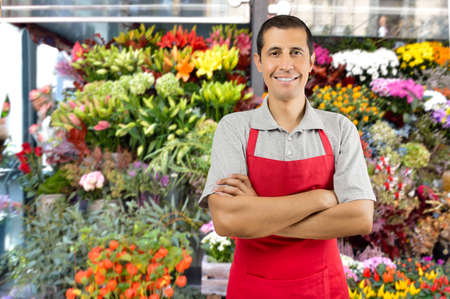 Shot of a shop man with crossed arms in a garden shop with plants and flowers Stock Photo