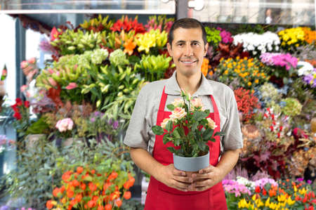 Shot of a man working in a garden shop with plants and flowers Stock Photo