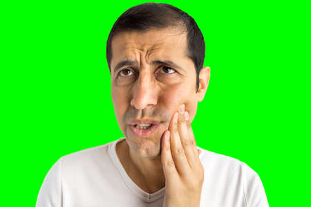 Shot of a man with bad toothache isolated cutout on green background with chroma key